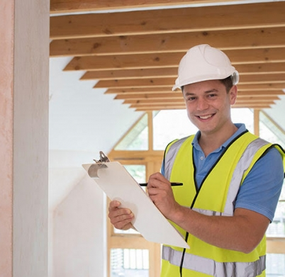 Portrait Of Building Inspector Looking At New Property